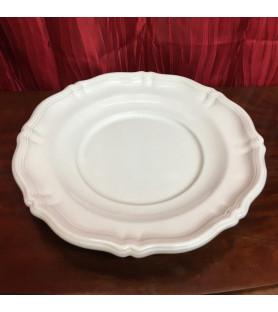 Grand plat blanc en faïence de Moustiers