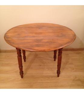 Petite table à volets en bois.