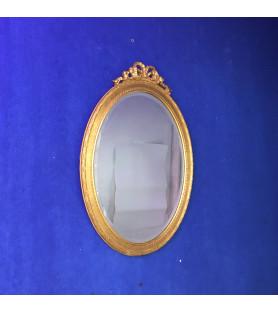Miroir en bois doré style Louis XVI.