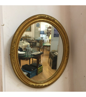 Miroir XIX éme en bois doré .