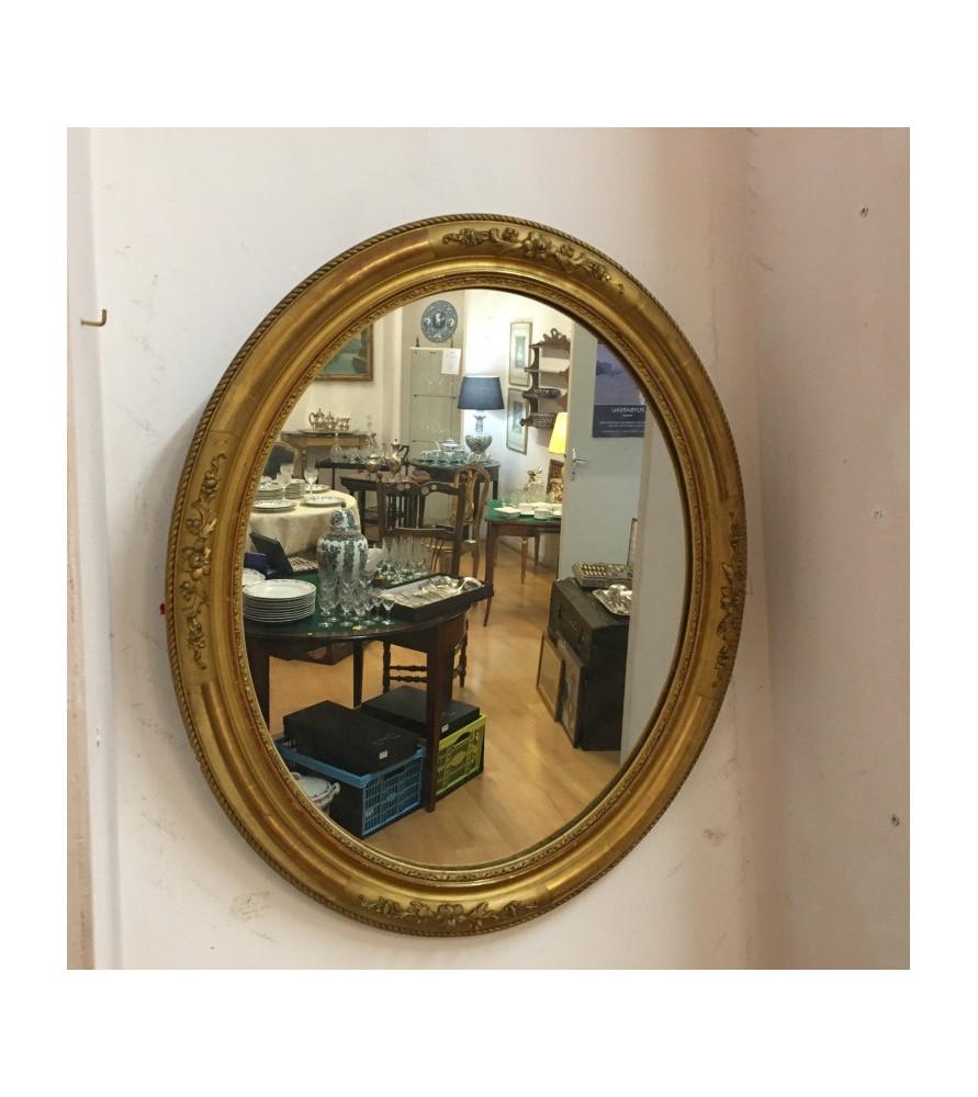 Miroir XIX ème en bois doré.