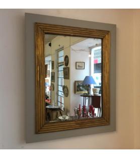 Miroir en bois laqué gris et moulures dorées XIXème