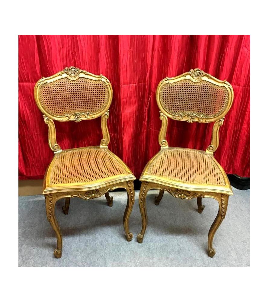 Paire de chaises cannées en bois doré style Louis XV